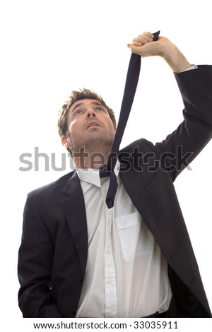 business contemplating suicide by hanging with necktie looking for rafter - stock photo
