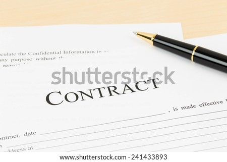 Business contract document with pen