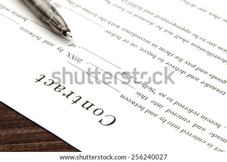 Business contract sheet and pen