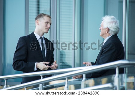 Business conversation two men outside the building - stock photo