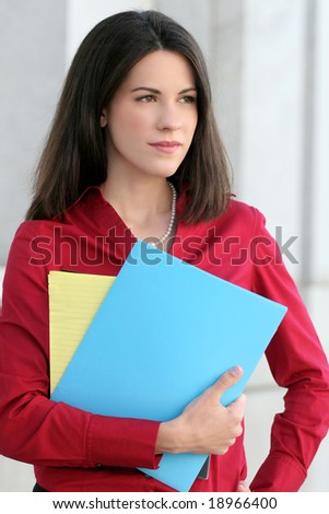 Business, corporate woman with folders, notepad and pencil, thinking about economic problems, outdoors - stock photo