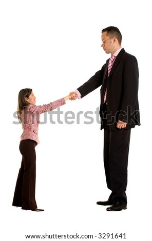 business couple doing a handshake where the businessman is a lot bigger than the businesswoman - good concept for merging companies - isolated over a white background