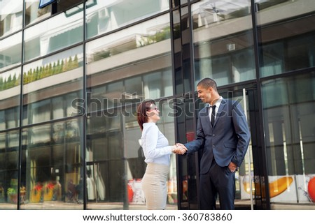 Business couple handshake.  - stock photo