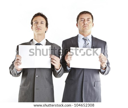 Business couple holding blank signs
