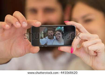 Business couple makes common selfie