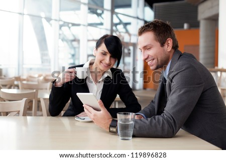 Business couple meeting with digital tablet
