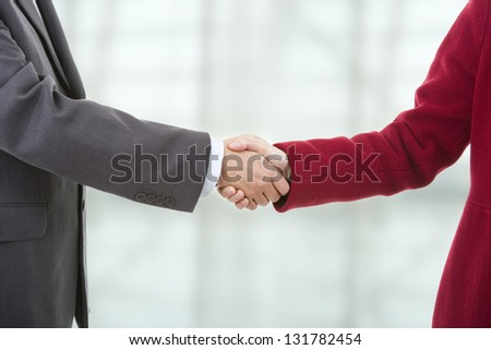 business couple shaking hands at the office - stock photo