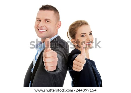 Business couple showing thumbs up. - stock photo