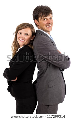 Business couple standing back to back smiling at the camera on white - stock photo