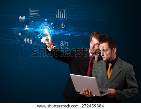 Business couple touching future web technology buttons and icons  - stock photo