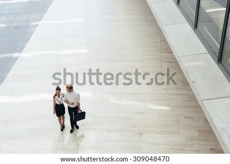 Business couple walking together. Top view - stock photo