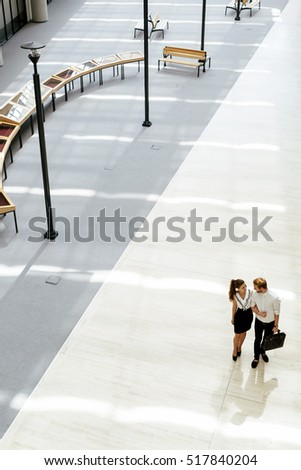 Business couple walking together. Top view