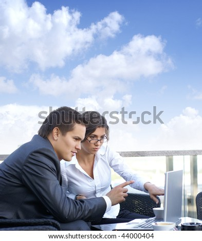 Business couple (Warning! Only woman's face is in focus, man' face is out of focus!)