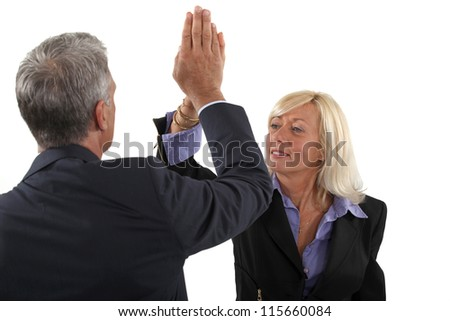 Business couple with their hands together - stock photo