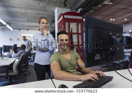 business couple working together on project at modern startup office