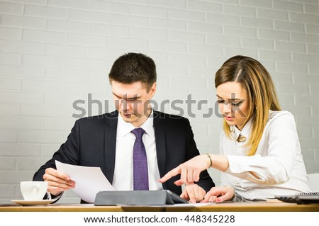 business couple working together on project at office - stock photo