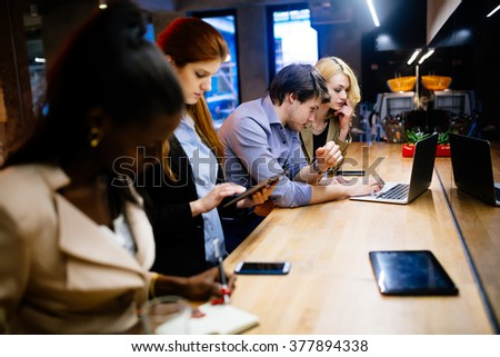 Business coworkers bonding in pub after work - stock photo