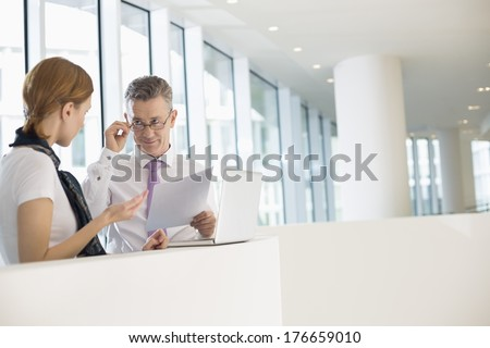 Business coworkers discussing work in office - stock photo