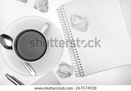 Business creativity concept. Sheets of paper and cup of coffee on table. - stock photo