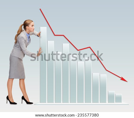 business, crisis, fail, statistics and people concept - busy businesswoman pushing graph falling down over gray background - stock photo