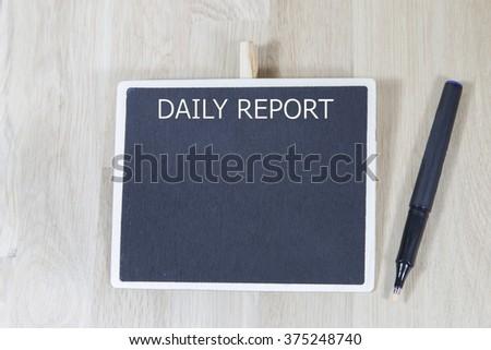 business  daily report blank list memo written on a blackboard with pen - stock photo