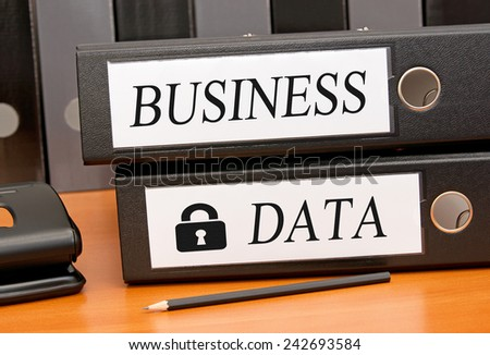 Business Data Security - two binders on desk in the office - stock photo