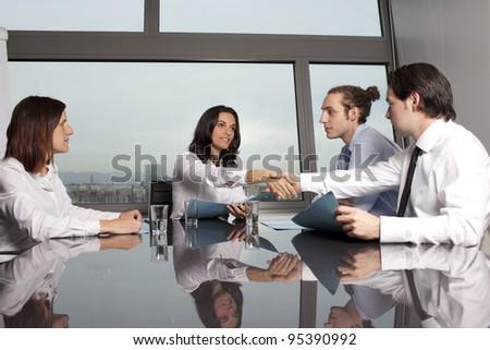 Business deal between businesspeople - stock photo