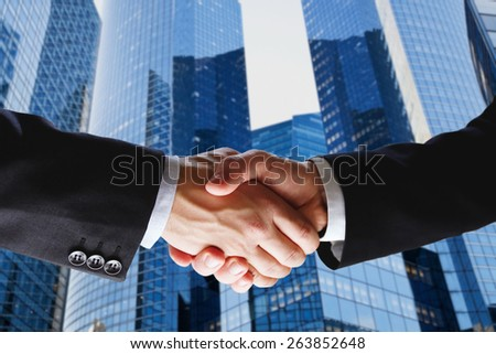 business deal, handshake on modern blue background - stock photo