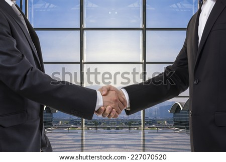 Business deal in an office building interior. - stock photo