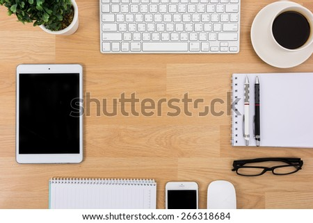 Business desk with a keyboard, mouse and pen on wooden table - stock photo