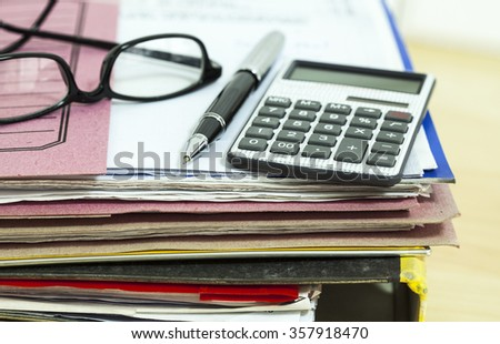 Business desk with file and eyeglasses - stock photo