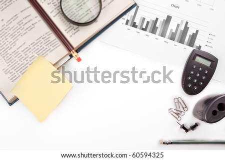 business desk with office stationery - stock photo