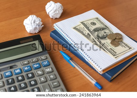 business desktop with calculator, notebook, money - stock photo
