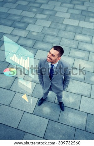 business, development and people concept - young smiling businessman with growth chart outdoors from top - stock photo