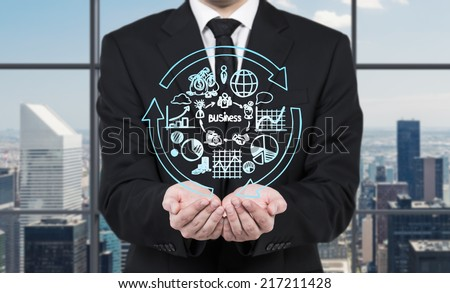 Business development concept, businessman holding flowchart - different stages of business development.  - stock photo