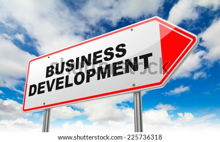 Business Development - Inscription on Red Road Sign on Sky Background.