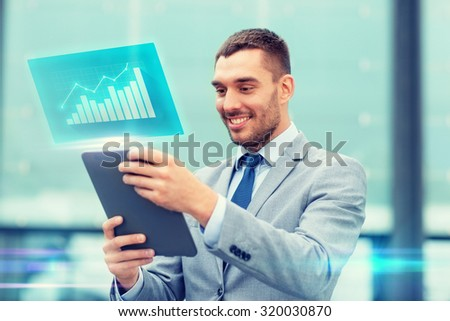 business, development, technology and people concept - smiling businessman working with tablet pc computer and virtual growth chart on city street - stock photo