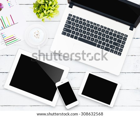 business device on workspace desk - stock photo