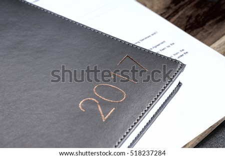 business 2017 diary on a wooden table