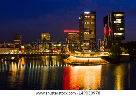 Business district of D���¼sseldorf and Rhine river at night - stock photo