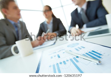 Business document on background of employees planning work at meeting