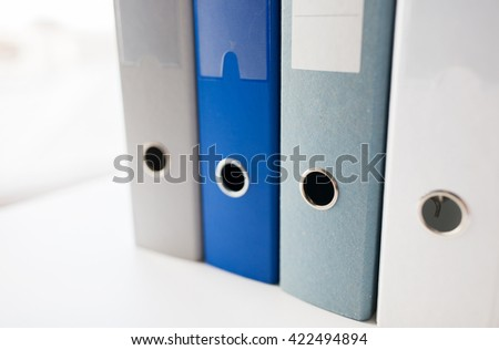 business, document, paperwork, office supply and education concept - close up of ring binders on table - stock photo