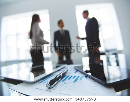 Business document, pen and gadgets at workplace - stock photo
