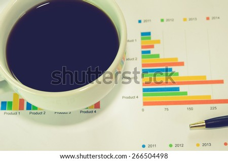 business documents and coffee on table,