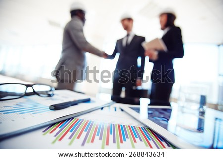 Business documents and touchpad in working environment
