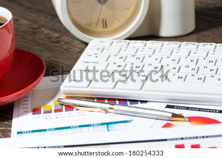 business documents, keyboard and pen. workplace businessman
