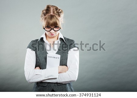 Business documents legal concept - closeup skeptical unhappy businesswoman holding contract in hands. Negative human emotion face expression feeling reaction - stock photo