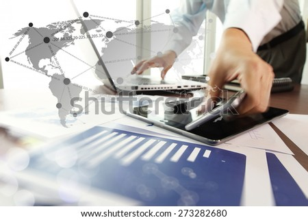 business documents on office table with digital tablet and man working with smart phone in the background with social network diagram concept  - stock photo