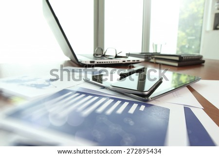business documents on office table with smart phone and digital tablet as work space business concept - stock photo