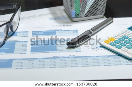 Business documents. Placed on the table with pen and calculator